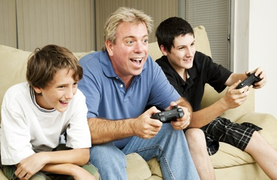 Foster carer dad and boys playing