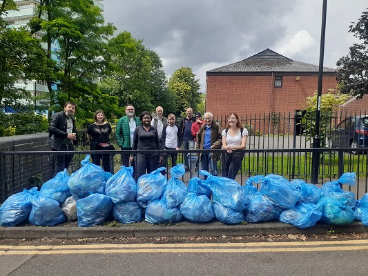 Litter pickers pose for photo