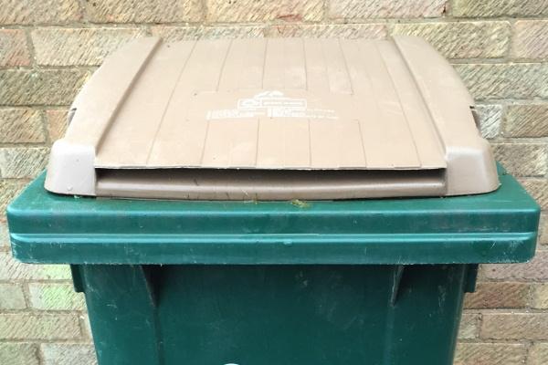 Brown lidded bin