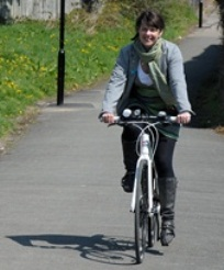 A person cycling to work.