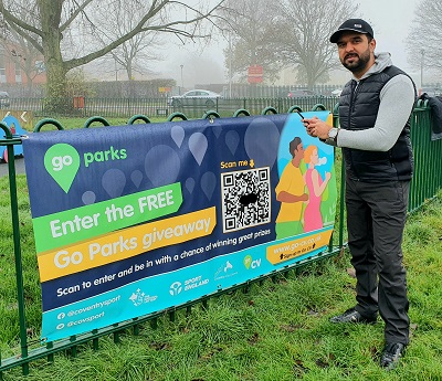 Cllr Kamran Caan scanning the code in one of the parks.