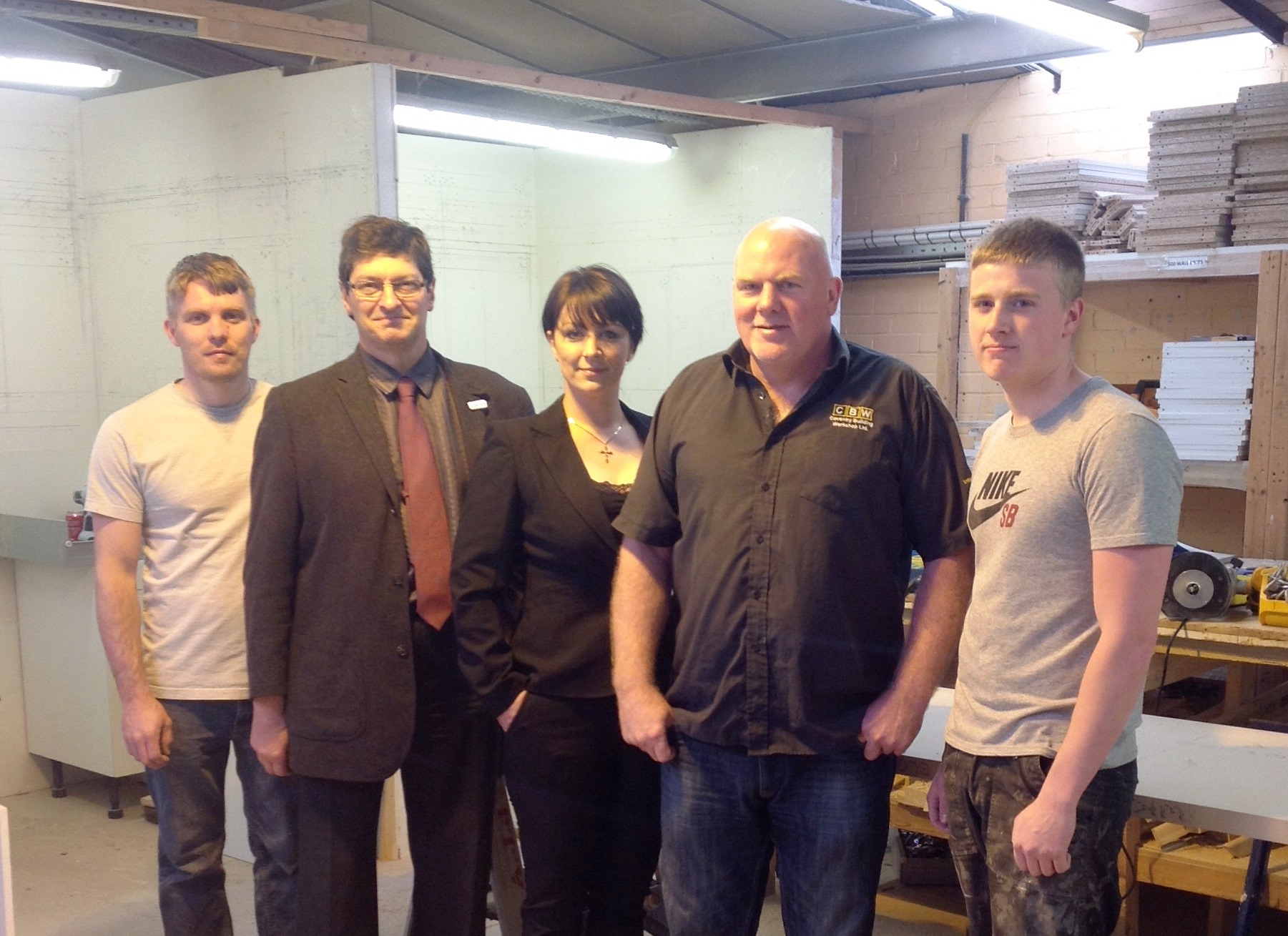 Cllr Kevin Maton, CBW manager Sara Tasker, Director Craig Foster and two learners at the Coventry Building Workshop.