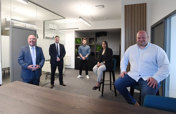 Caption: From the left, Cllr Jim O'Boyle (Coventry City Council and CWLEP), Adam Plumb (CWLEP Growth Hub), Scott Riddell (SCCU Group), Kierandeep Bal (Coventry City Council) and James Pease (SCCU Group) at the newly-refurbished offices at the SCCU Group