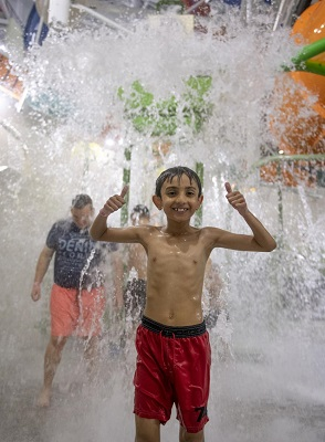 A schoolchild enjoys the Wave waterpark