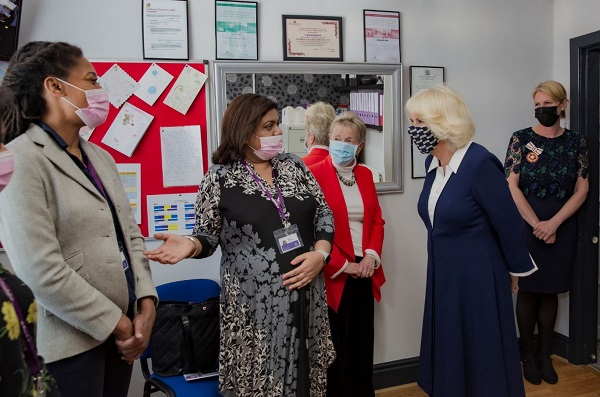 The Duchess of Cornwall speaking to representatives from the family