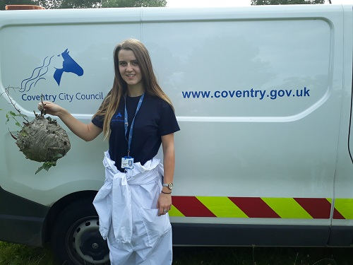 One of the Councils Pest Control Team with a wasps nest.