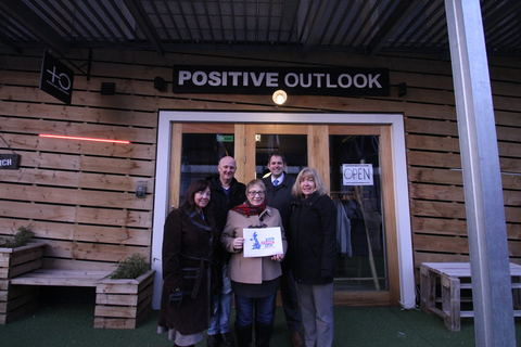 Social enterprise partners outside Positive Outlook clothing store in Fargo Village